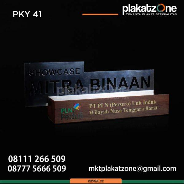Plakat Kayu PT PLN Unit Induk Wilayah Nusa Tenggara Barat